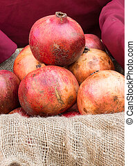 group of fresh red pomegranates fruits