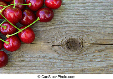 Group of Fresh Ripe Red Sweet Cherries on Wooden Background....