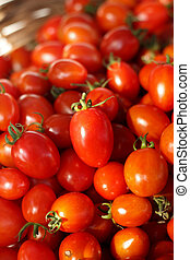Group of fresh tomatoes in basket.