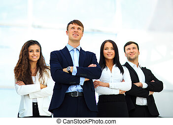 Group of friendly businesspeople with male leader in front