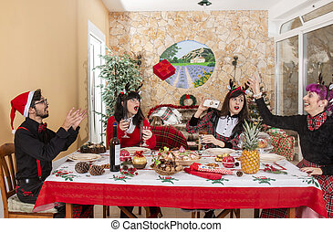 group of friends at christmas table