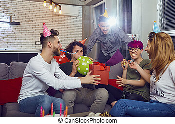 Group of friends celebrating birthday at a party.