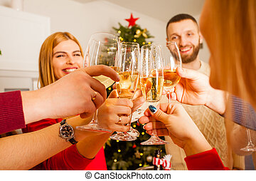 Group of friends celebrating New Year with champagne in their hands