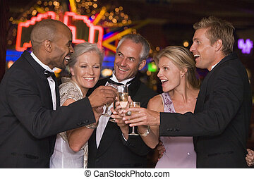 Group of friends celebrating win in casino - Group of ...