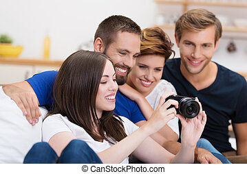Group of friends checking out a photo