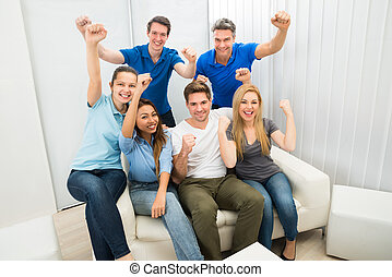 Group Of Friends Cheering