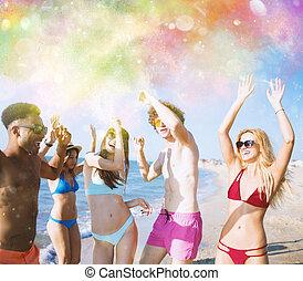 Group of friends dance under a color splash