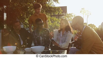 Group of friends discussing on a rooftop - Multi-ethnic ...