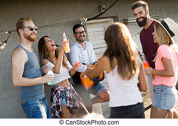 Group of friends enjoying party on rooftop