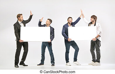 Group of friends giving a high-fives - Group of cheerful...