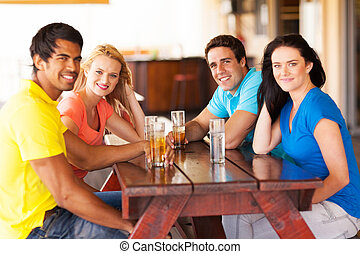 group of friends hanging out at bar