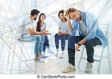 Group of friends having a talk with psychologist