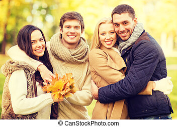 group of friends having fun in autumn park