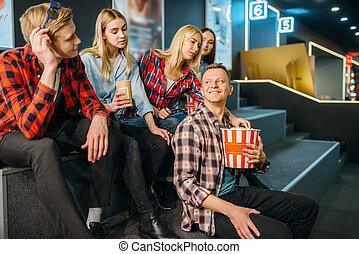 Group of friends having fun in cinema