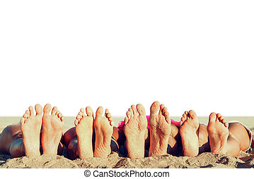 Group of friends having fun on the beach with their foots. Concept of summertime. Isolated on white background