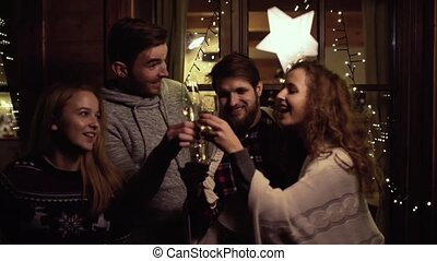 Group of friends having party on New Years Eve. - Group of ...