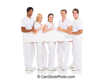 group of friends holding blank banner and giving thumb up