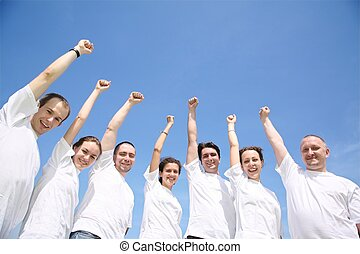Group of friends in white T-shorts have waved upwards hands
