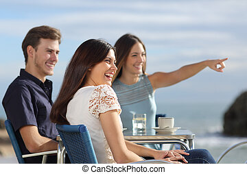 Group of friends looking at horizon in a restaurant