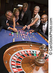 Group of friends of gambling in casino