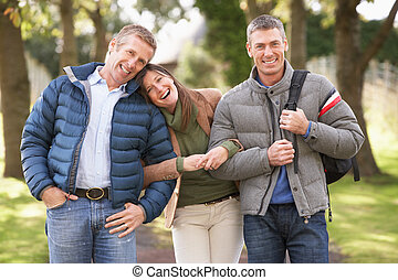 Group Of Friends On Walk In Autumn Park Together