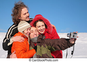 group of friends photographs itself in winter