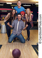 Group of friends playing in bowling