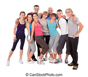 Group of friends posing at the gym - Large group of diverse...