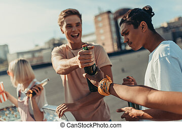 group of friends sharing beer
