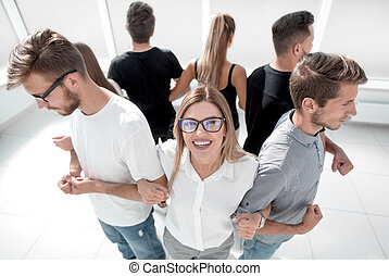 group of friends standing in a circle