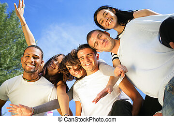 Group of friends stood in park