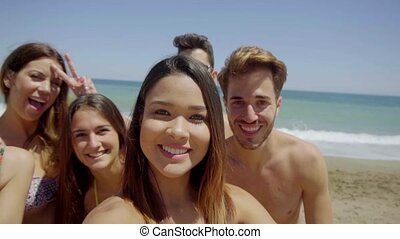 Group of Friends Taking Selfie on Sunny Beach