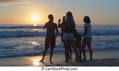 Group of friends taking selfie on the beach 4k