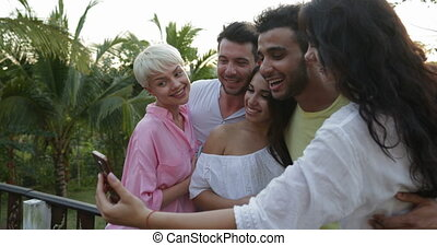 Group Of Friends Taking Selfie Photo On Cell Smart Phone On...