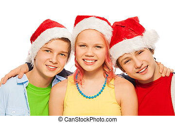 Group of friends teens together in Xmas Santa caps