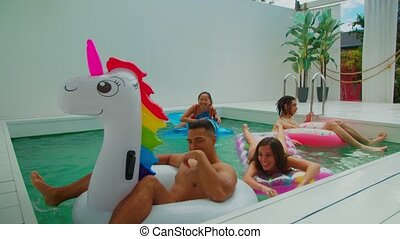 Group of friends together in swimming pool leisure