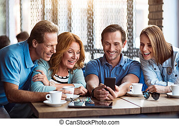 Group of friends using phone