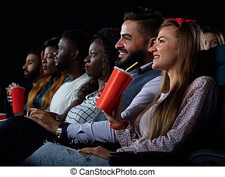 Group of friends watching movies at the local cinema