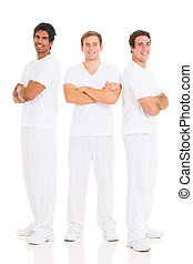 group of friends with arms crossed - group of handsome...