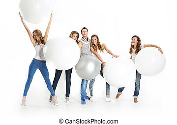 Group of friends with big white bal