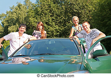 Group of friends with car outdoor