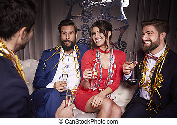 Group of friends with champagne at new year's party
