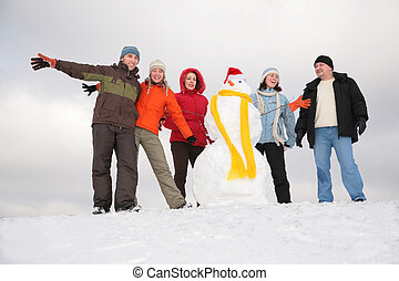 group of friends with snowman