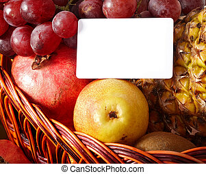 Group of fruit in basket with banner.