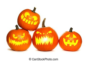Group of fun lit Halloween Jack o Lanterns isolated on a white background