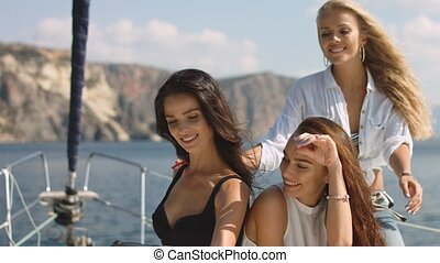 Group of girlfriends taking a selfie on luxury yacht