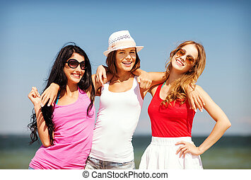 group of girls chilling on the beach