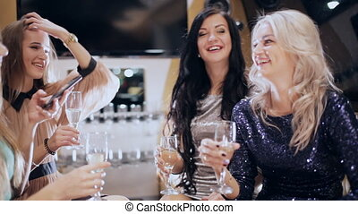 Group of girls drinking champagne in a limousine - Girls...