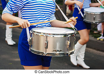 group of girls drummers. parade on a city street