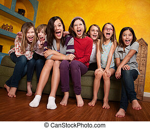 Group of happy barefoot girlfriends scream out